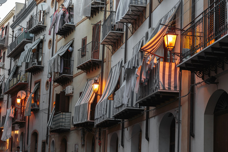 late summer: PALERMO, ITALY - SEPTEMBER 21 2015: Buildings in the City of Palermo on a warm late summer day