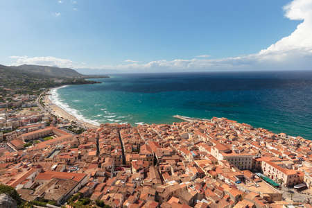 coastal city: Fantastic Landscape at the italien sicilian Coastal City of Cefalu. Warm summer colors. Lovely sea and mediterranean historical houses. Lovely Sight and european travel destination in Italy