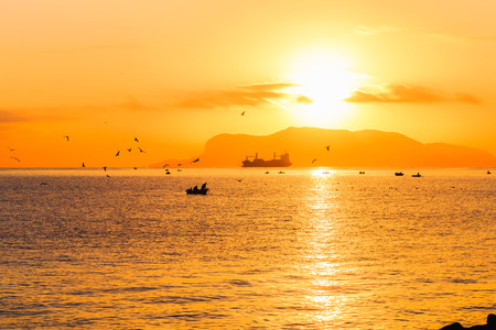 colores calidos: With Love from Sicily. Dramatic Sunrise over the Mediterranean Sea. Romantic Dawn from Palermo, Italy on the island of sicily. Picturesque warm colors and silhouettes of fishing boats in the morning