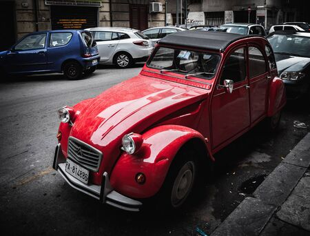streetlife: PALERMO, ITALY - OCTOBER 10 2015: Old vintage cars parking in palermo
