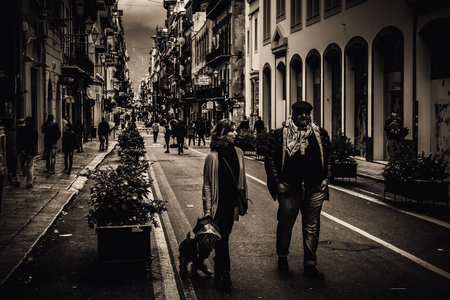 streetlife: PALERMO, ITALY - NOVEMBER 01 2015: Picture from the stormy and wet November 1st in the sicilian capital of Palermo, Italy. Vintage Sepia Black and White Editorial