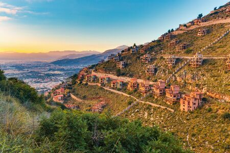 mondello: unfinished house ruins raised by the Mafia through corruption on a hill near Palermo. Sicilian Landscape near Mondello, Italy