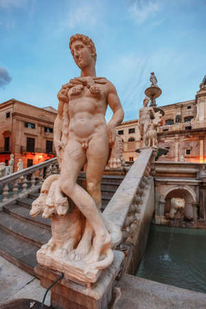 illustrious: PALERMO, ITALY - NOVEMBER 22 2015: Grand Piazza Pretoria at the Blue Hour in Palermo, Sicily, Italy. Blue Orange Contrast of the historical buildings