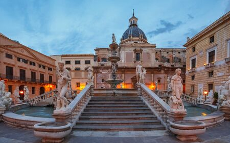 PALERMO, ITALY - NOVEMBER 22 2015: Grand Piazza Pretoria at the Blue Hour in Palermo, Sicily, Italy. Blue Orange Contrast of the historical buildings