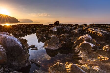 subtropical: Captivating Coastal Sunset near Palermo on the island of Sicily, Italy. Lovely subtropical winter landscape at the sea. Enchanted Atmosphere in the evening