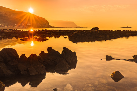 captivating: Captivating Coastal Sunset near Palermo on the island of Sicily, Italy. Lovely subtropical winter landscape at the sea. Enchanted Atmosphere in the evening