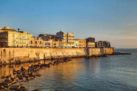 syracuse: Travel Photography from Syracuse, Italy on the island of Sicily. Coastal Town sunrise with historical landmarks and monuments Stock Photo