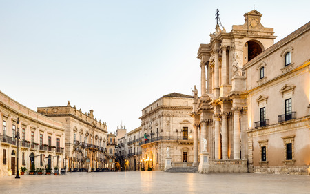 baroque architecture: Travel Photography from Syracuse, Italy on the island of Sicily. Cathedral Plaza. Large open Square at sunrise
