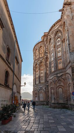 atmospheric: MONREALE, ITALY - JANUARY 05 2016: Outdoor Cathedral of Monreale. Warm Winter January. Travel and Tourist Destination. Christian Catholic Medieval Architecture