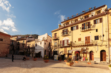 atmospheric: MONREALE, ITALY - JANUARY 05 2016: Outdoor City Shot of the mediterranean city of Monreale on Sicily in Italy, Europe on a warm and sunny Winter Day Editorial