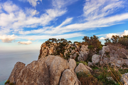 wandering: Wandering in the Hills of Palermo, Italy at Monte Pellegrino on the island of Sicily. Hiking Trip in January with an amazing view on the green island Stock Photo