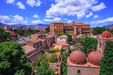 hermits: Lovely View on the old cloister of saint john in Palermo, Sicily, Italy on a warm spring morning. Citiview with view on the palace in the background