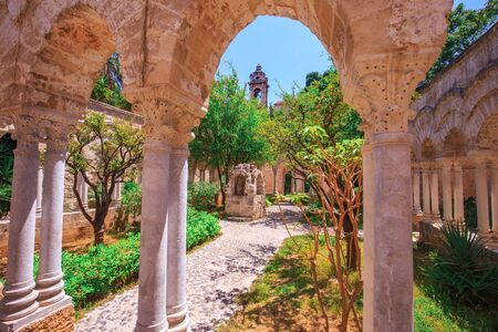 hermits: Lovely View on the old cloister of saint john in Palermo, Sicily, Italy on a warm spring morning Stock Photo