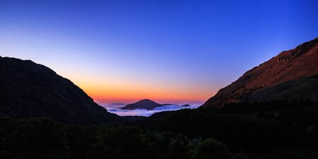 tranquil atmosphere: Cloudy Landscape covering the hills of Sicily. Lovely evening Sunset in the Madonie Mountains of Italy, Europe. Tranquil Serene Atmosphere
