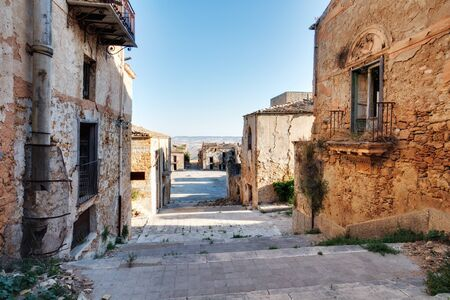 tranquil atmosphere: Sicilian Ghost Town of Poggioreale in Italy, Europe. Picturesque Cityscapeof an abandoned place in mediterranean landscape on a hot July summer day. Amazing tranquil and serene ghostly atmosphere Stock Photo