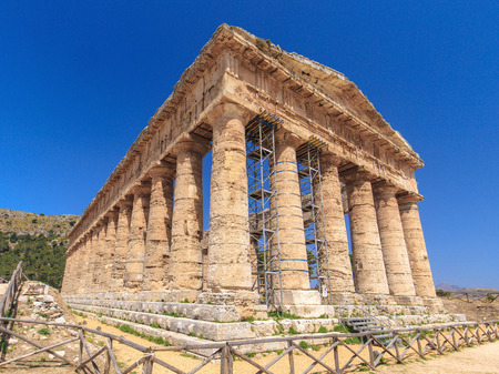 segesta: Temple of Segesta in central Sicily. Never completely finished greek antique temple site in Italy, Europe on a hot summer day Stock Photo