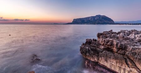 mondello: Mornig Coast Sunrise on Island Sicily in Italy, Europe with sunrays and clouds. Amazing landscape and water