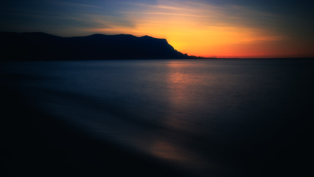 Sunset Beach with lovely orange sky near Palermo, Sicily