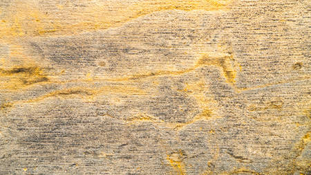 Background of old yellow stone texture. Фото со стока