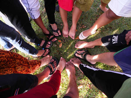 adult's feet: A GROUP OF FEET FORM CIRCLE Stock Photo