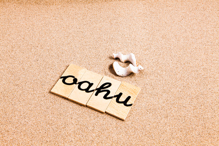 oahu: Words FORMED from small pieces of wood container containing a sun and beach tourist destination Oahu