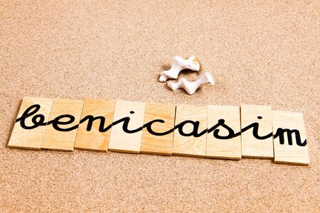 appoints: Words FORMED from small pieces of wood container containing a sun and beach tourist destination Benicasim