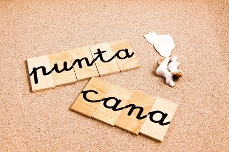 appoints: Words FORMED from small pieces of wood container containing a sun and beach tourist destination Punta Cana