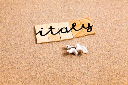 appoints: Words FORMED from small pieces of wood container containing a sun and beach tourist destination Italy