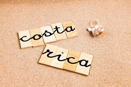 season s greeting: Words FORMED from small pieces of wood container containing a sun and beach tourist destination Costa Rica Stock Photo