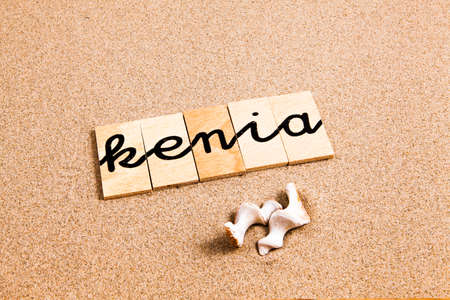 appoints: Words FORMED from small pieces of wood container container container containing a sun and beach tourist destination Kenya Stock Photo