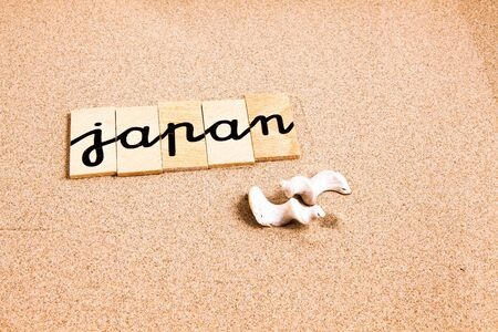 season s greeting: Words FORMED from small pieces of wood container container containing a sun and beach tourist destination Japan Stock Photo