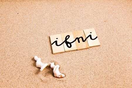 season s greeting: Words FORMED from small pieces of wood container container containing a sun and beach tourist destination Ifni Stock Photo