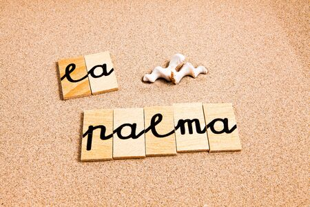 designates: Words FORMED from small pieces of wood container containing different letters La Palma Stock Photo