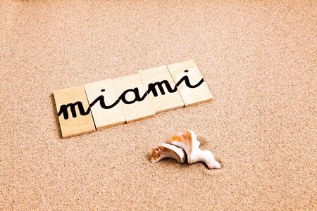 designates: Words FORMED from small pieces of wood container containing different letters Miami Stock Photo