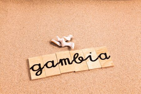 appoints: Words FORMED from small pieces of wood container containing a sun and beach tourist destination Gambia Stock Photo