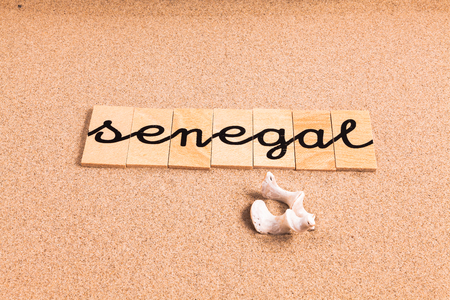 appoints: Words FORMED from small pieces of wood container containing a sun and beach tourist destination Senegal Stock Photo