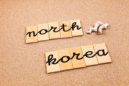 appoints: Words FORMED from small pieces of wood container containing a sun and beach tourist destination North Korea