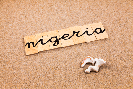appoints: Words FORMED from small pieces of wood container containing a sun and beach tourist destination Nigeria