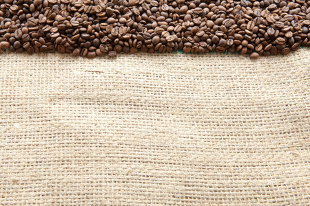 macrobiotic: Coffee beans seen from above pouch of jute naturally illuminated with light Stock Photo
