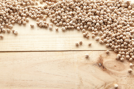 macrobiotic: Chickpeas seen from above pouch of jute naturally illuminated with light