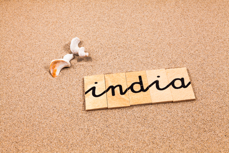 appoints: Words FORMED from small pieces of wood container containing a sun and beach tourist destination India