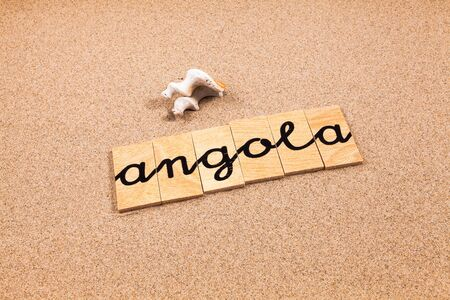 appoints: Words FORMED from small pieces of wood container containing a sun and beach tourist destination Angola