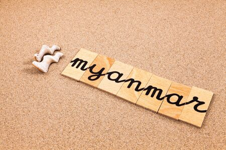 appoints: Words FORMED from small pieces of wood container containing a sun and beach tourist destination Myanmar