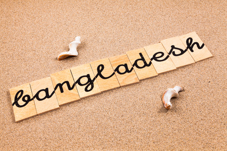 season s greeting: Words FORMED from small pieces of wood container containing a sun and beach tourist destination Bangladesh