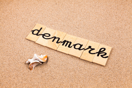 appoints: Words FORMED from small pieces of wood container containing a sun and beach tourist destination Denmark Stock Photo