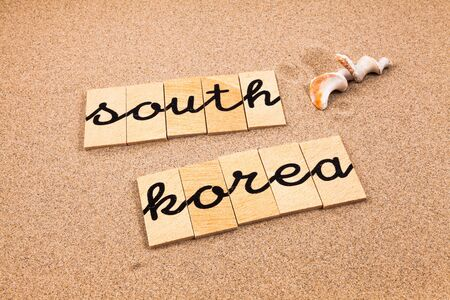 appoints: Words FORMED from small pieces of wood container containing a sun and beach tourist destination South Korea