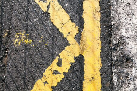 otras palabras clave: asphalt and paint cracked and worn