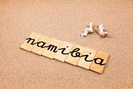 appoints: Words FORMED from small pieces of wood container containing a sun and beach tourist destination Namibia Stock Photo