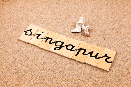 appoints: Words FORMED from small pieces of wood container containing a sun and beach tourist destination Singapore