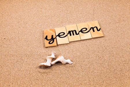 appoints: Words FORMED from small pieces of wood container containing a sun and beach tourist destination Yemen Stock Photo